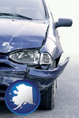 ak map icon and an automobile accident, hopefully covered by insurance