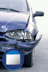 colorado map icon and an automobile accident, hopefully covered by insurance
