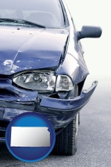 ks map icon and an automobile accident, hopefully covered by insurance