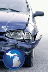 mi map icon and an automobile accident, hopefully covered by insurance