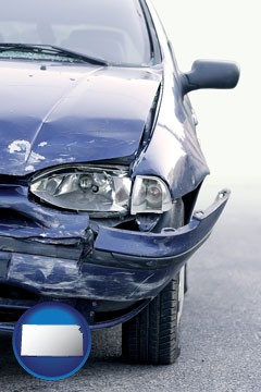 an automobile accident, hopefully covered by insurance - with Kansas icon