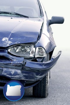 an automobile accident, hopefully covered by insurance - with Oregon icon